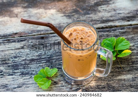 Ice coffee on a wooden table - stock photo