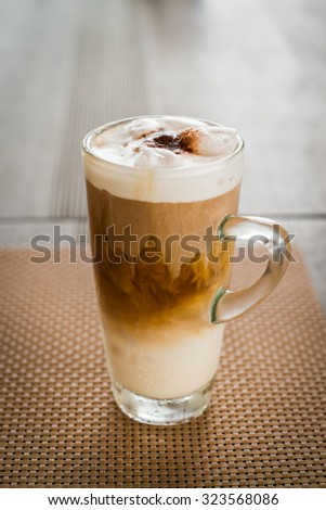 Ice coffee on a wooden table - vintage effect style pictures - stock photo