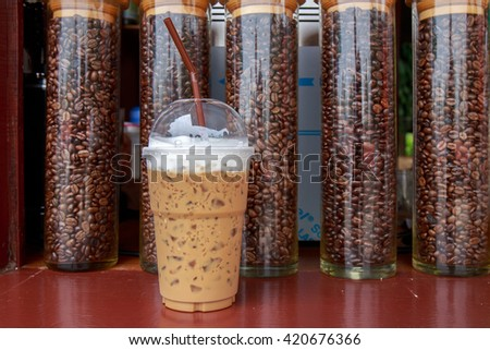 Ice coffee on coffee bean bottle background. - stock photo