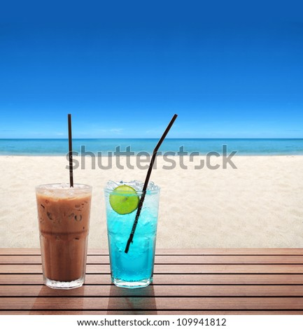 ice coffee with blue soda with lime on the summer beach - stock photo