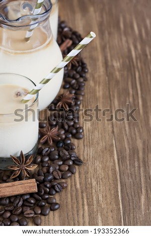 Ice coffee with spices in jug and glasses. Selective focus. Copy space background. - stock photo