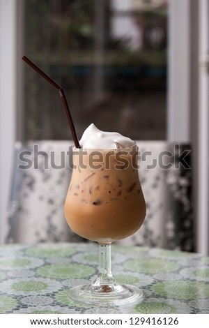 Ice Coffee with whipping cream - stock photo