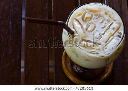 Ice cold coffee on a wooden table - stock photo