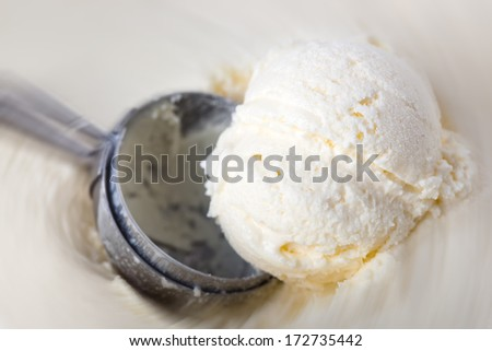 ice cream in a bowl with leaf
