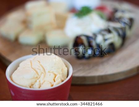 Ice Cream Vanilla and candy dishes. - stock photo