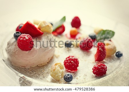 Ice cream with berries and mint leaves on plate