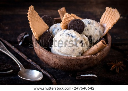 Ice cream with cookies and cone in wooden bowl,selective focus  - stock photo