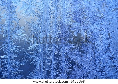Ice crystals on a window (winter background).