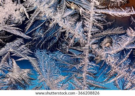 ice crystals texture on frozen winter window  - stock photo