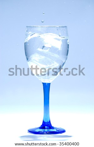 ice cube and transparent water in glass