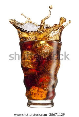 Ice cube droped in cola glass and cola splashing