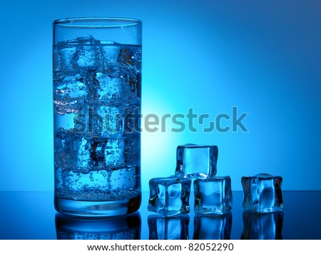 Ice cubes and cold water in glass
