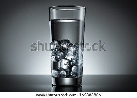 Ice cubes filled in a glass of water - stock photo