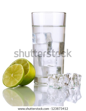 Ice cubes in glass with lime isolated on white