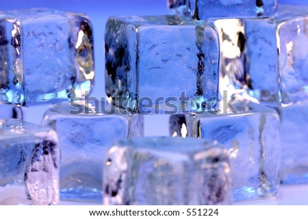 Ice cubes on blue background. - stock photo