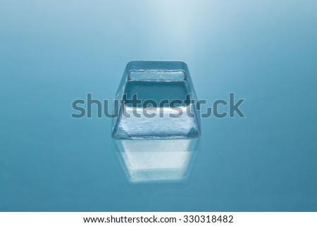 ice cubes on glass table - stock photo