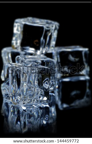ice cubes on the black  background with reflection