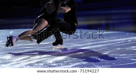 Ice figure skating pair with shadows on ice - stock photo