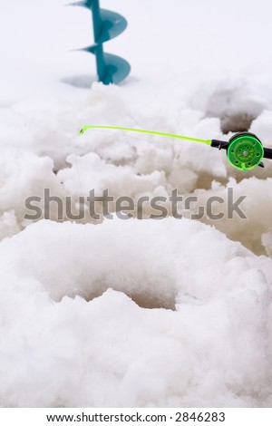 Ice fishing scene - stock photo