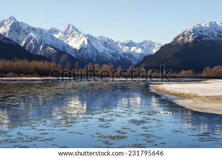 Ice floating in the Chilkat River near Haines Alaska on a sunny November day. - stock photo
