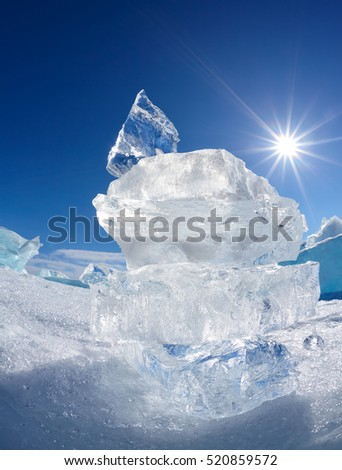 Ice floe crystal and sun over winter Baikal lake