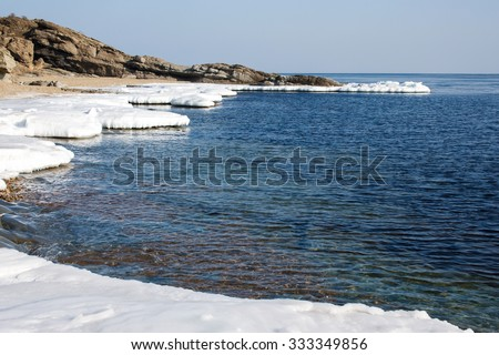 Ice Floe, Icy shore of the sea,  North sea, cold sea of the North, winter ice, white snow of the Arctic, Arctic ocean. Beach at the winter ocean. Spring Arctic. Melting of ice - stock photo