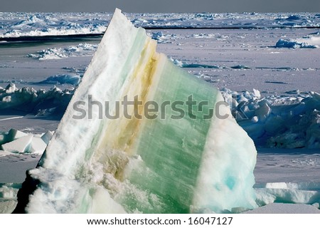 Ice floe with colorful layers - stock photo