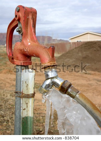 ice formation on a frozen outdoor tap - stock photo