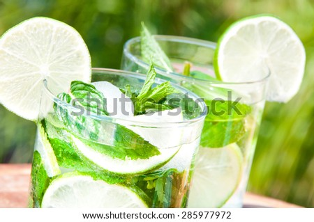 Ice fresh mojito cocktail on hot summer day - stock photo