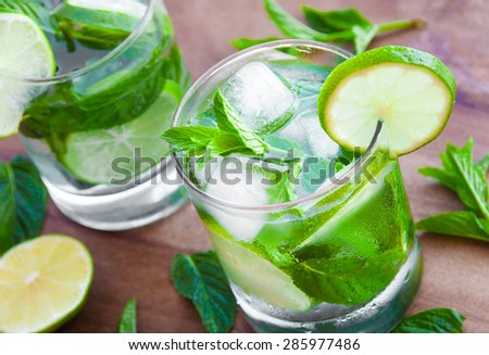 Ice fresh mojito cocktail on wooden table - stock photo