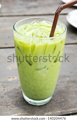 Ice Green tea with a straw - stock photo