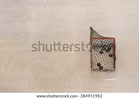 Ice hockey goal with copy space on ice skating rink texture background - stock photo