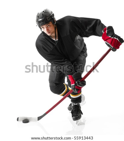 Ice hockey player handling puck and skating forward. Photo on white background - stock photo