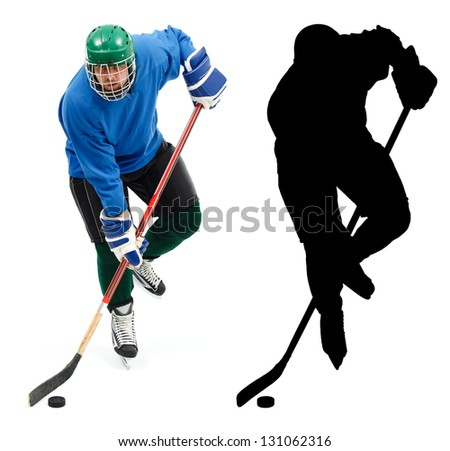 Ice hockey player in blue wear, skating fast and handling puck. - stock photo