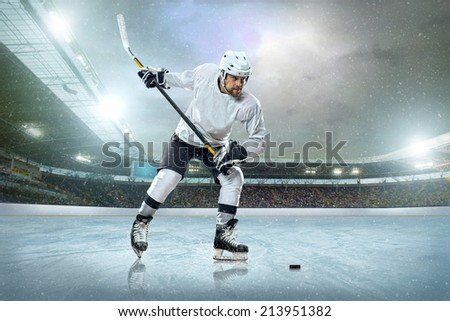 Ice hockey player on the ice. Open stadium - Winter Classic game. - stock photo