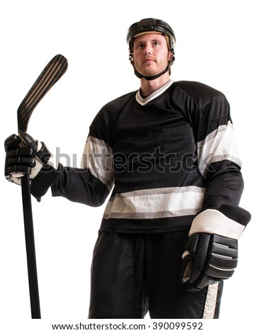 Ice hockey player. Studio shot over white. - stock photo