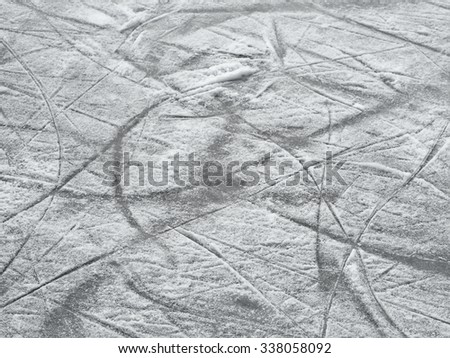 Ice hockey rink surface backround, skate marks texture - stock photo