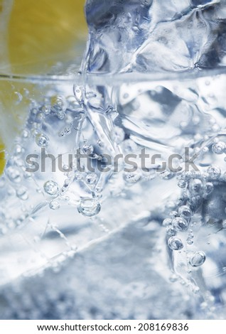 Ice in glass of water - stock photo