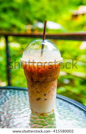 Ice Latte Coffee in Plastic Glass, Thailand. - stock photo