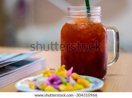 Ice lemon tea while reading the book. - stock photo