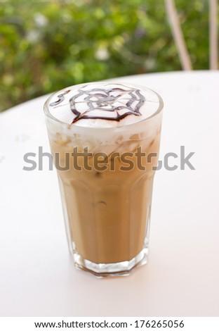Ice mocca coffee with foam milk. - stock photo