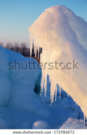 ice mountains with icicles at sunset light