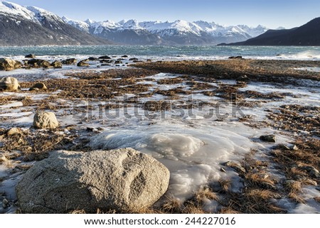 Ice on an Alaskan beach near Haines, Alaska in winter. - stock photo