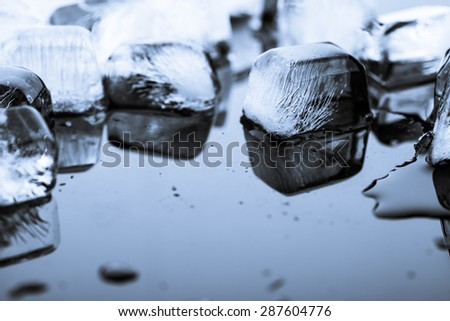 ice on black background - stock photo