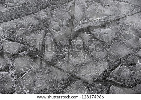 Ice on frozen river in winter - stock photo