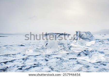 Ice on the frozen lake. Beautiful winter landscape. Small depth of field - stock photo