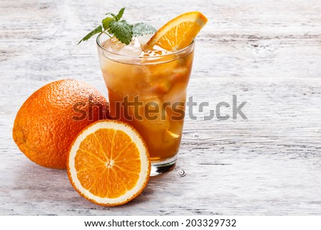 Ice orange tea on wood table  - stock photo
