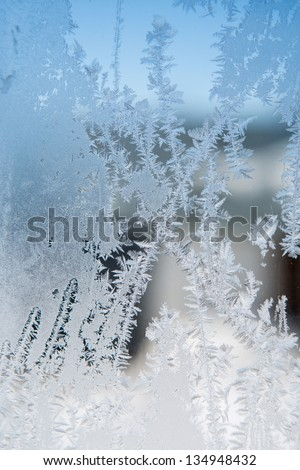 ice patterns on winter glass - stock photo