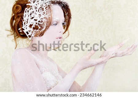 Ice princess woman holding something  - stock photo