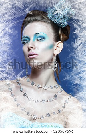 ice-queen. Young winter woman in creative image with silver blue artistic make-up and perfect hairstyle.